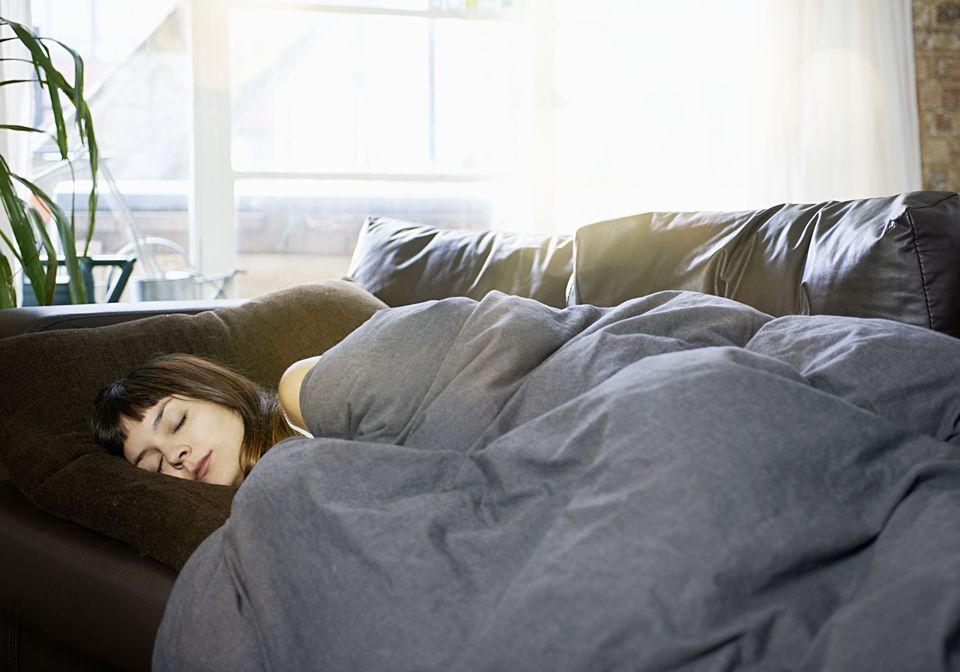woman asleep on sofa
