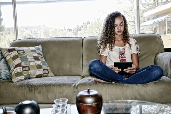 Mixed race girl using digital tablet