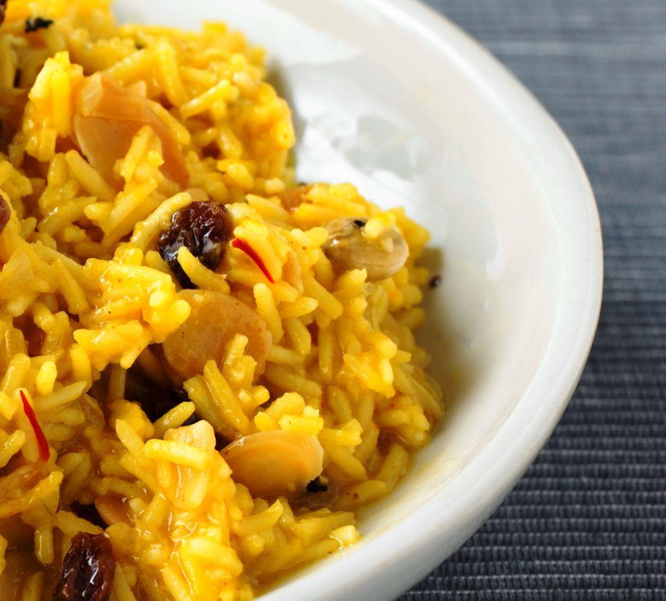 Vegetable rice Biryani with almonds and raisins