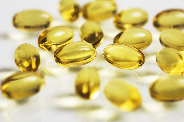 Cod liver oil capsules on White background