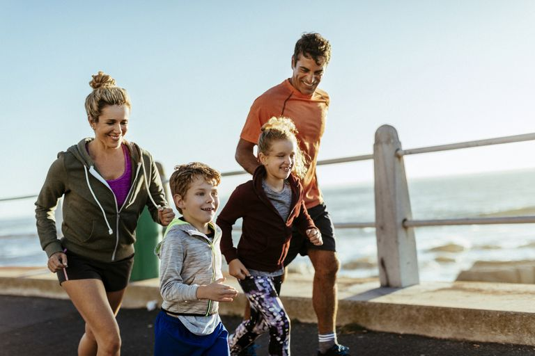 Family having fun running