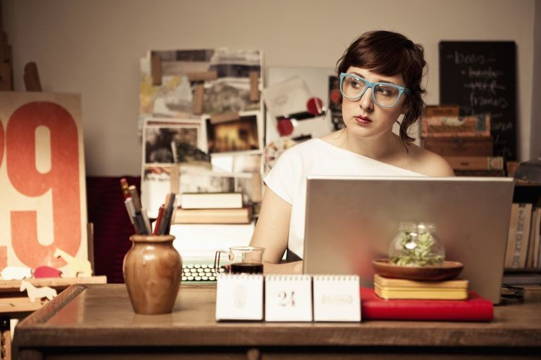 Woman blogging from home office