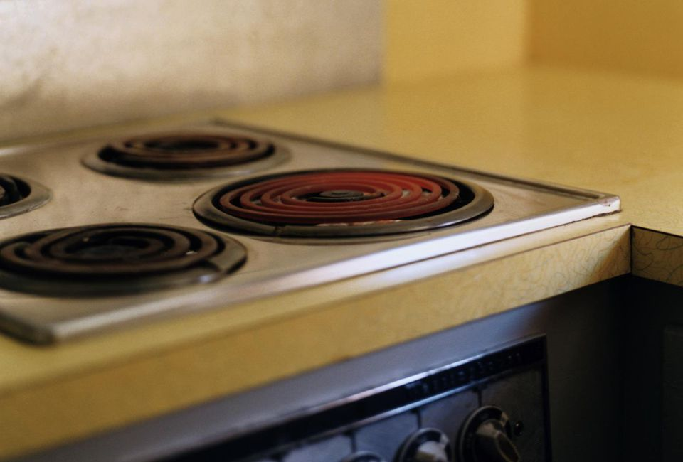 Electric stove hob lit in kitchen
