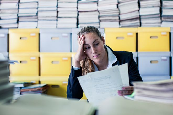 Frustrated business woman at company filing for bankruptcy