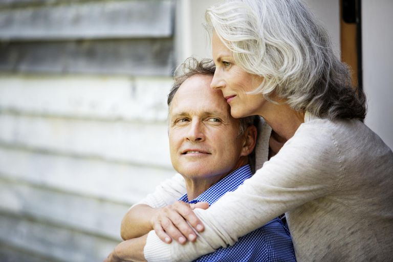 Senior Woman with Arms Around her Husband