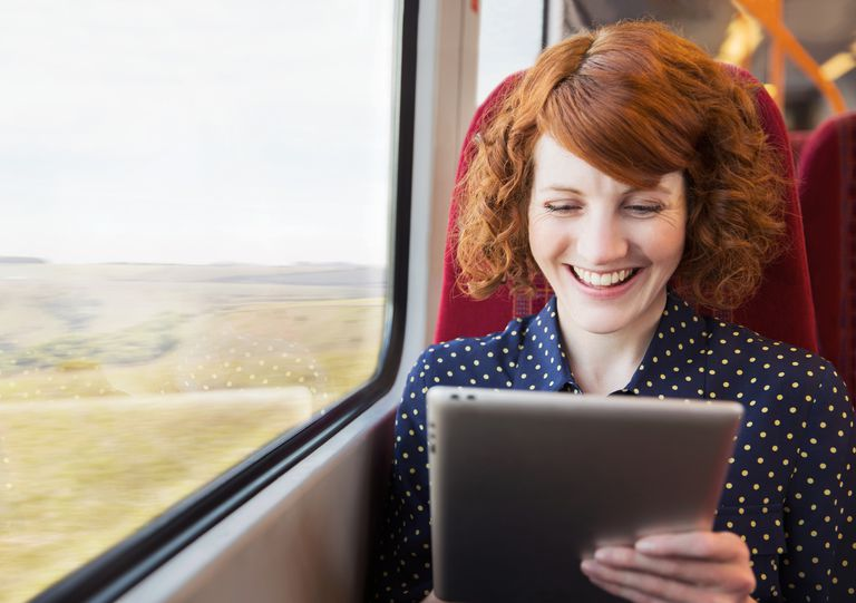 Woman using tablet on a train