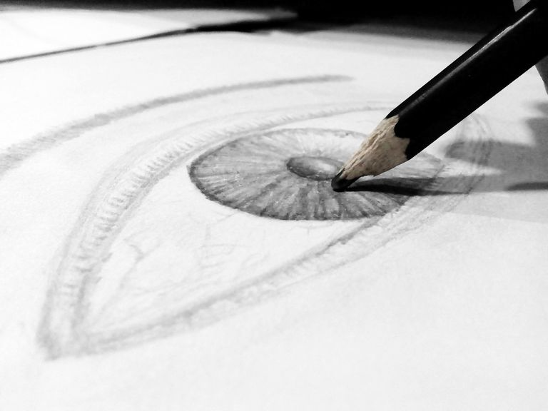 Close-Up Of Human Eye Drawing On Paper