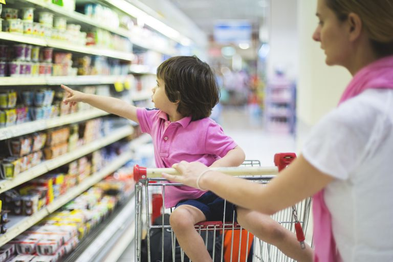 Small boy in grocery store with mother