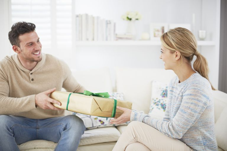 woman receiving gift from man