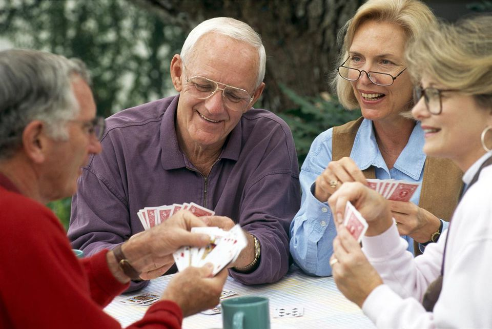 Senior couples playing cards