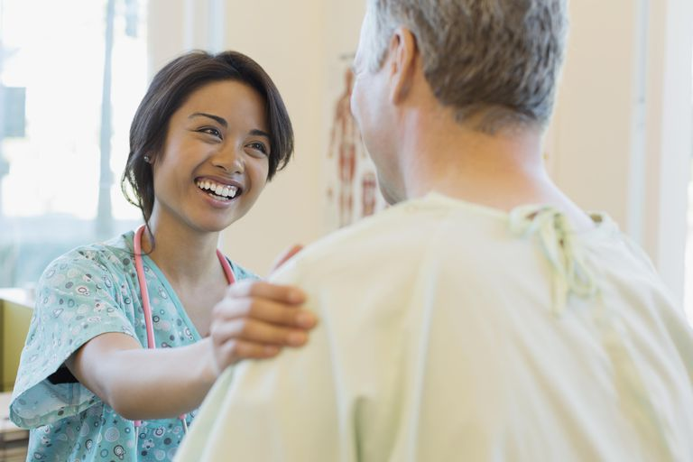 health care professional talking to a patient
