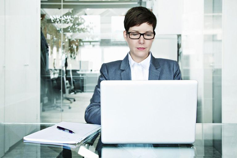 Business woman at laptop at office