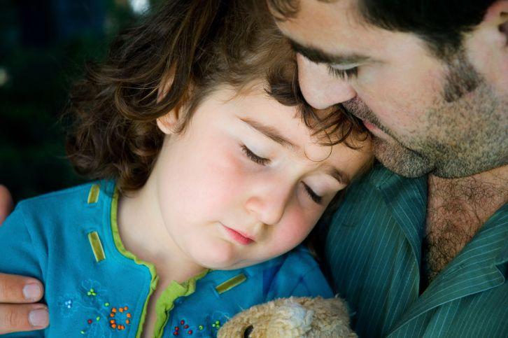 A sick preschooler with her dad.