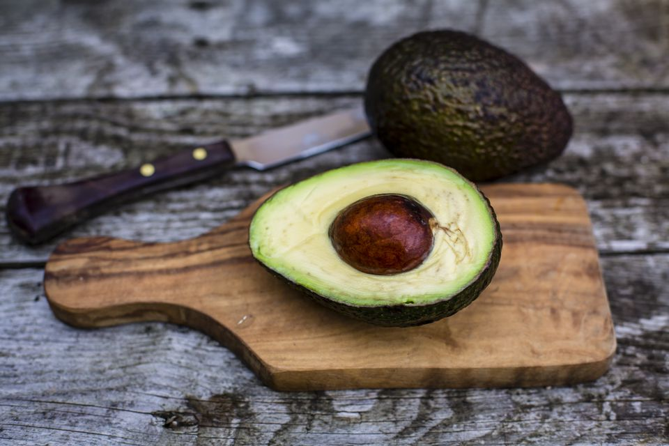 Chopped avocado on chopping board