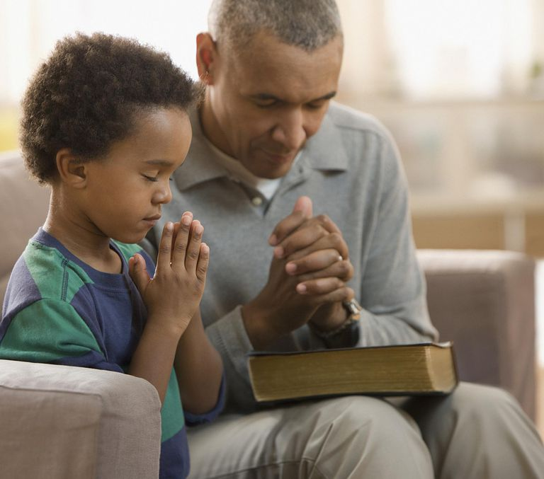 grandfather and grandson praying together