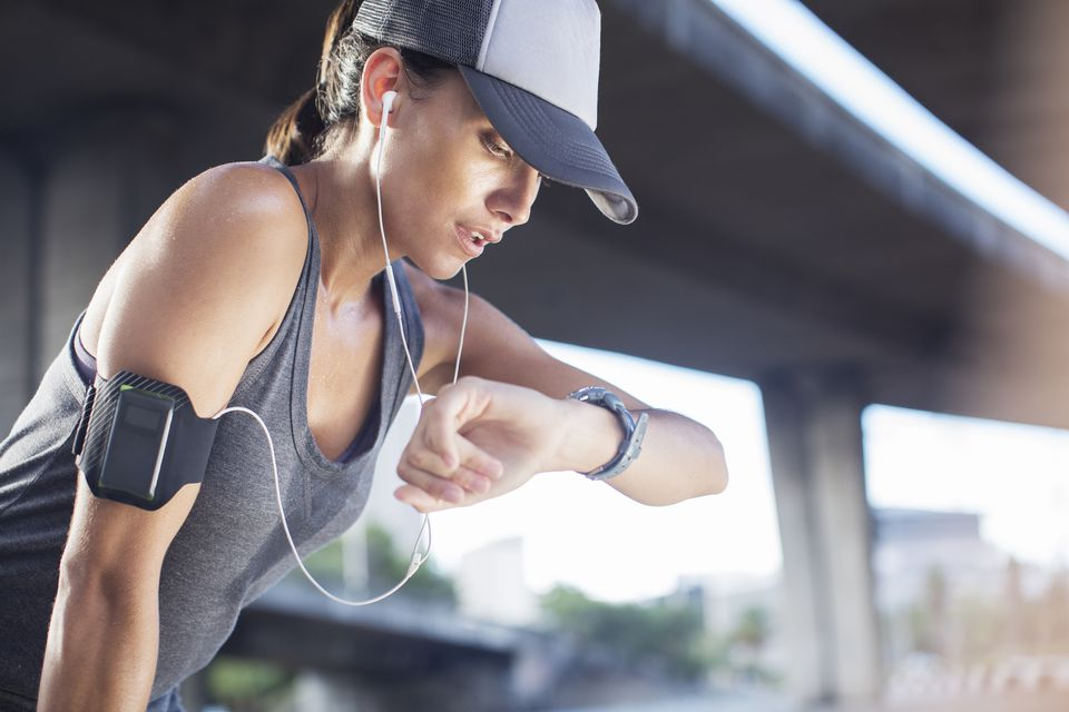 Woman in baseball cap exercising