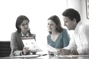 financial advisor speaking with clients