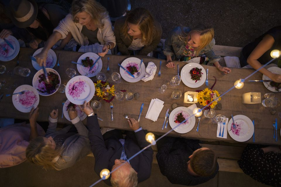 Overhead shot of friends at an outdoor dinner party