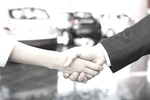 Salesperson Shaking Hands With Female Customer