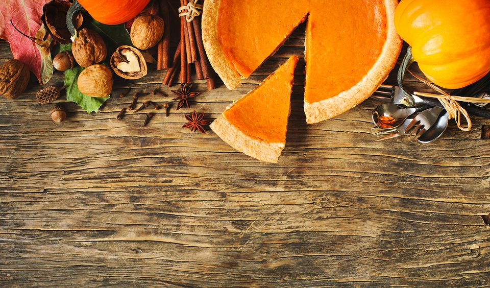 Autumn background with pumpkin pie, pumpkins, nuts and spices.