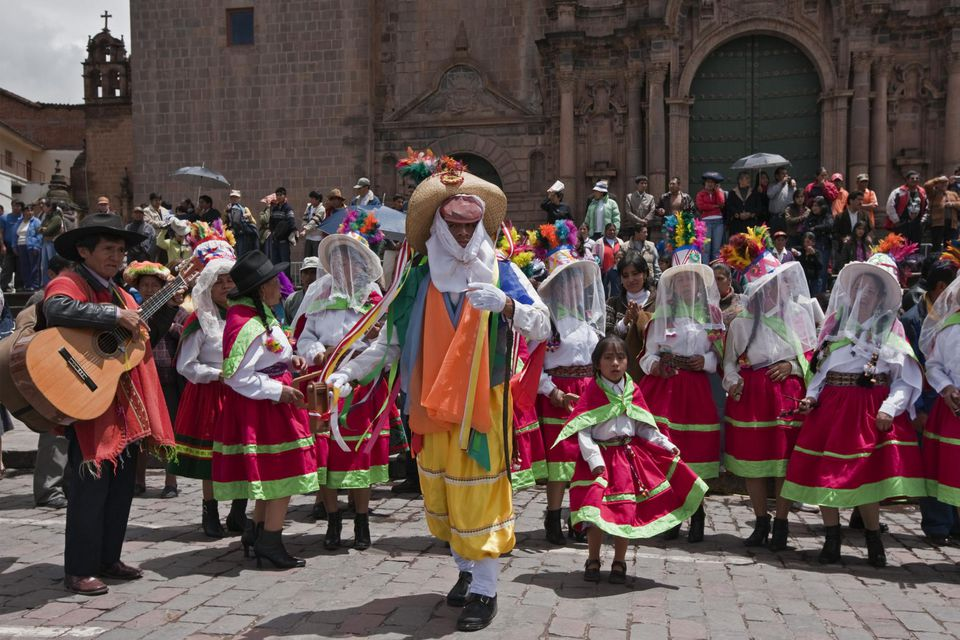 Peru, Masked dancers on Christmas Day in Cusco s square, Plaza de Armas, celebrating the Andean Baby Jesus, Nino Manuelito.