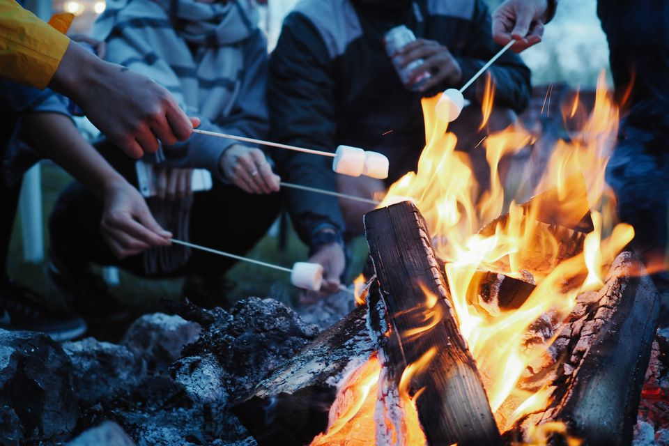 Low Section Of People Having Marshmallows On Barbecue