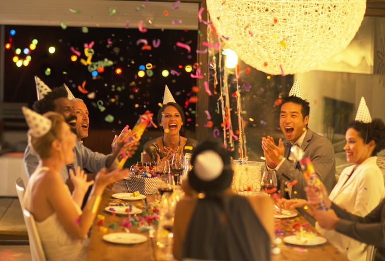 Friends throwing confetti at birthday party