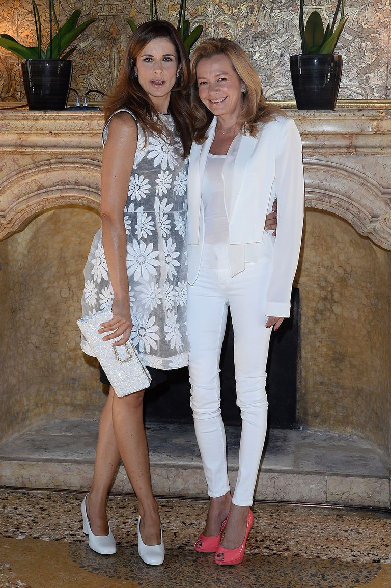 Caroline Scheufele (with Livia Firth), dressed in bright coral shoes, and white skinny jeans.