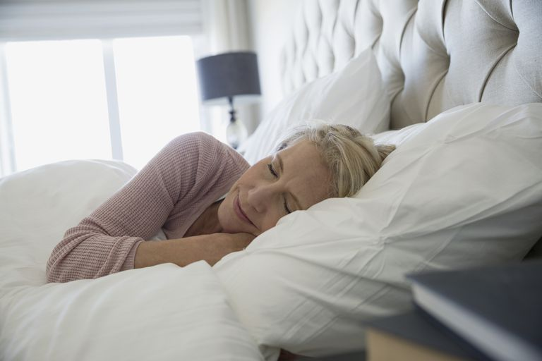 Comfortable woman sleeping in bed