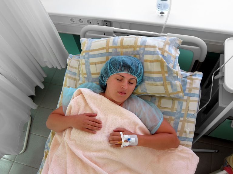 Woman lying in the hospital after the operation