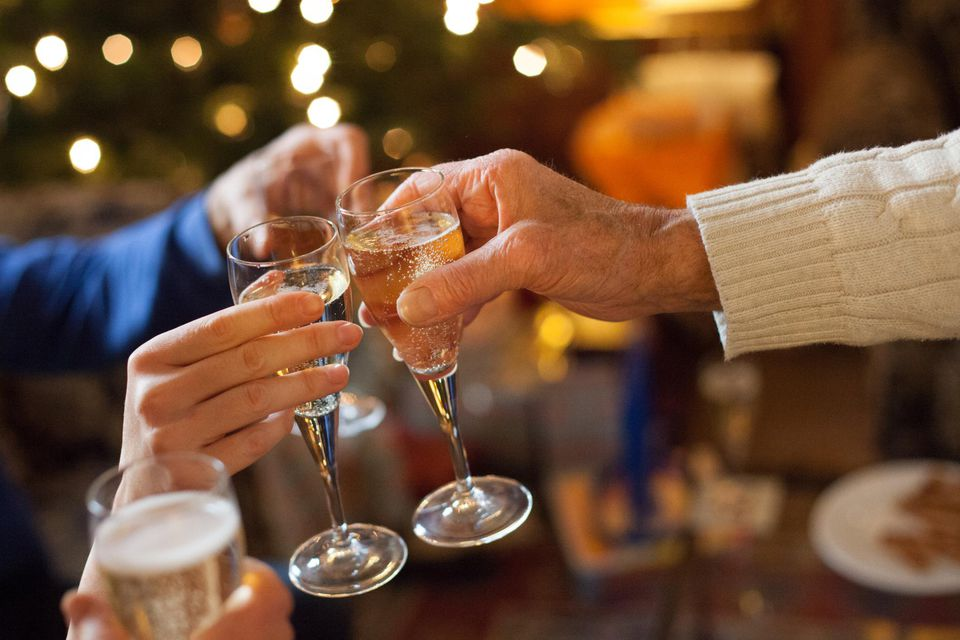 Family toasting with champagne at Christmas