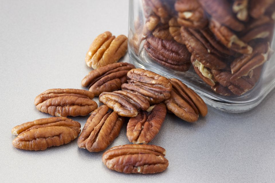 Pecan nuts on stainless steel counter