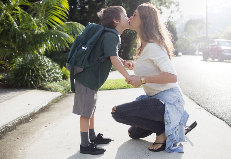 Mom kisses son as he heads off to school