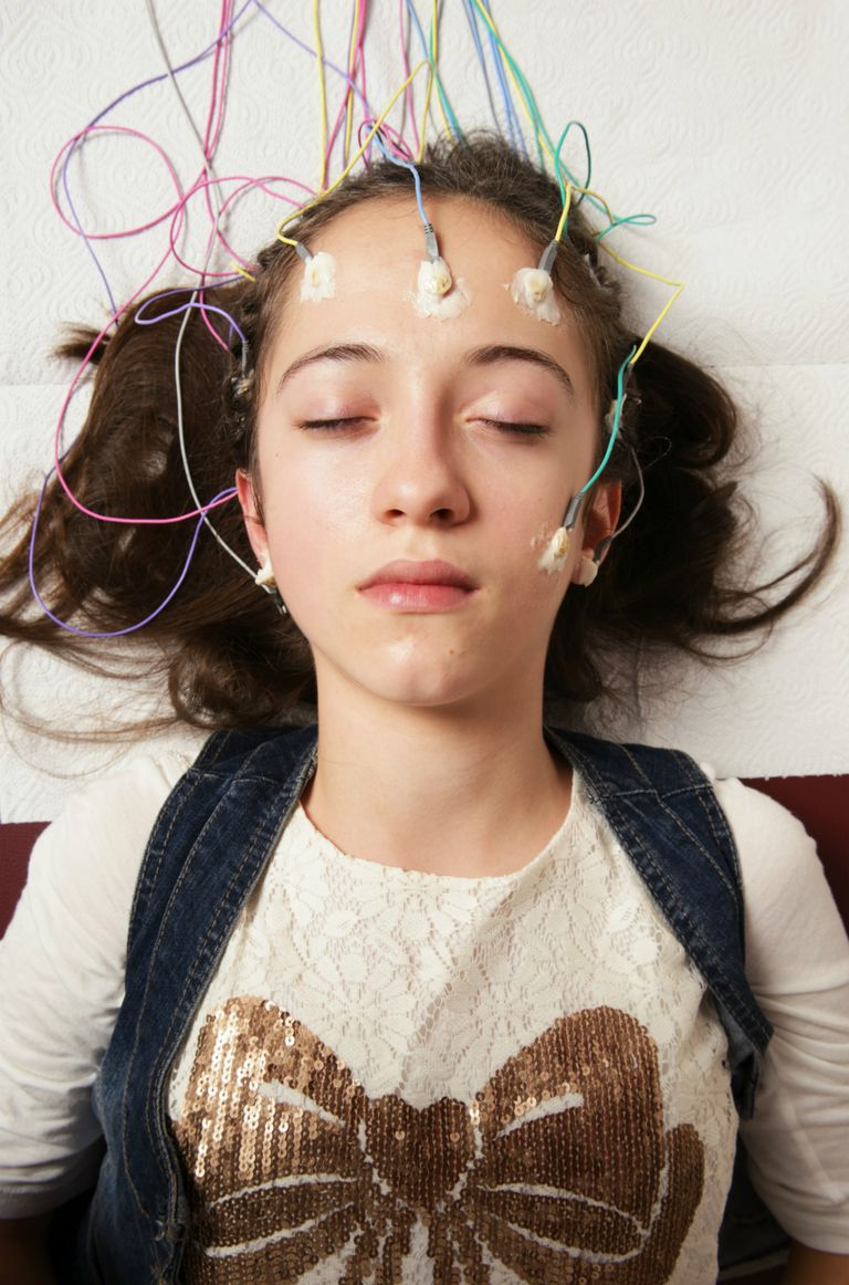 Young woman receiving EEG exam