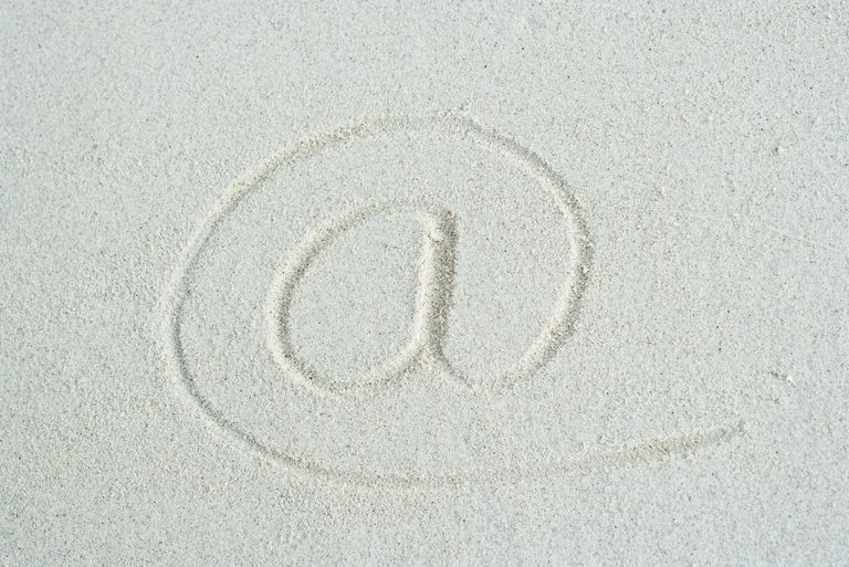 At symbol traced in sand, close-up