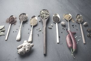 Variety of herbs and spices on slate background