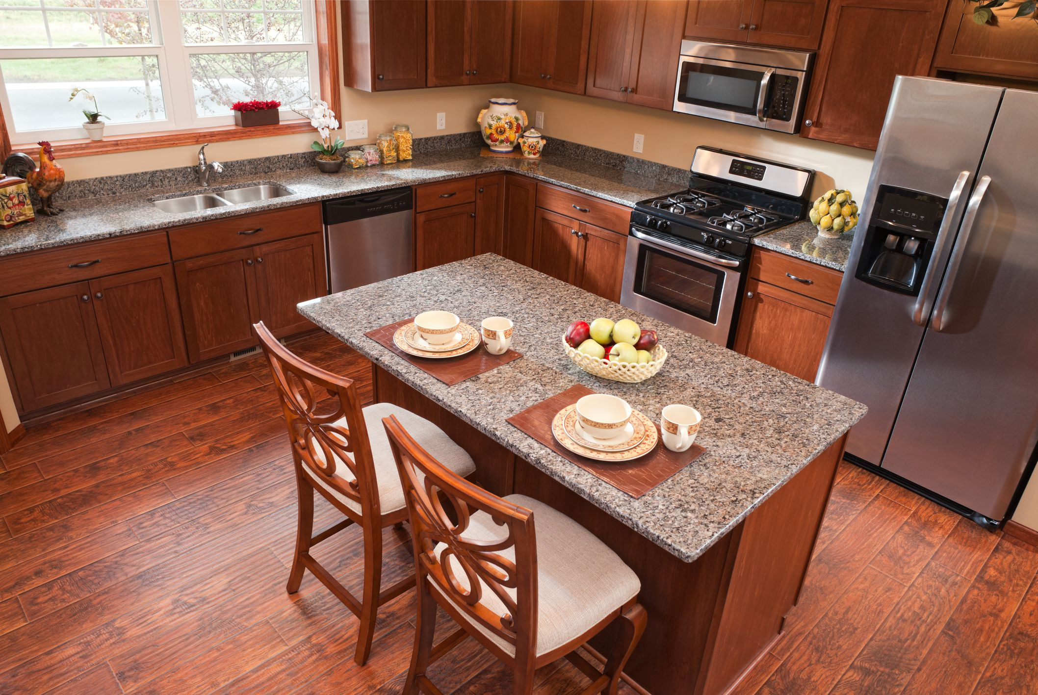 Can you install laminate flooring in the kitchen for Floor and decor kitchen cabinets