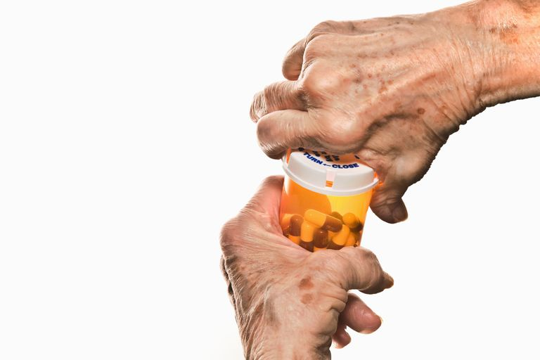 Pill Bottle Opened by Struggling Senior