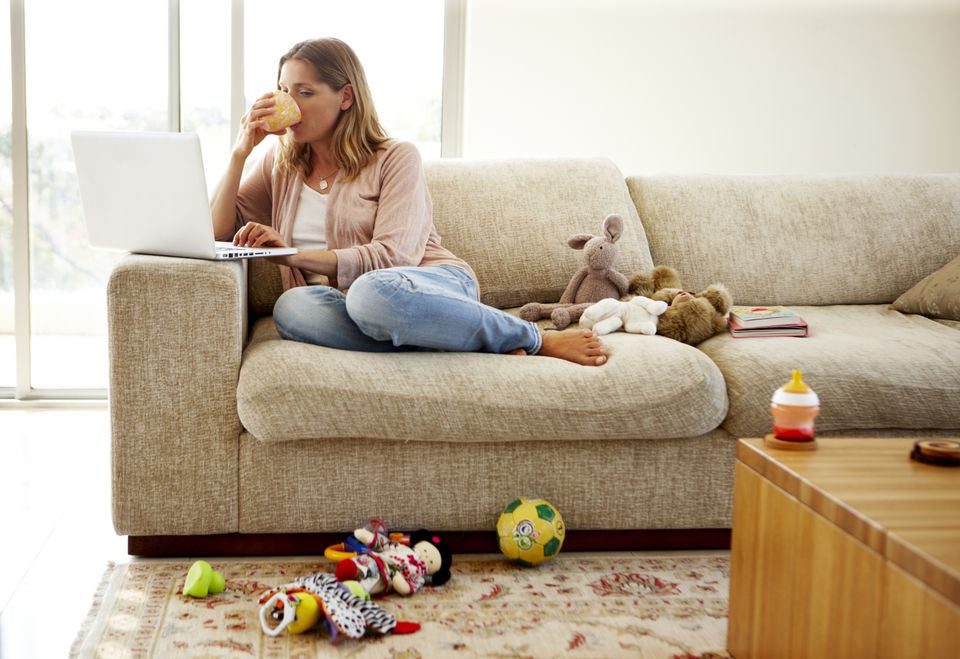 woman working on computer at home on couch