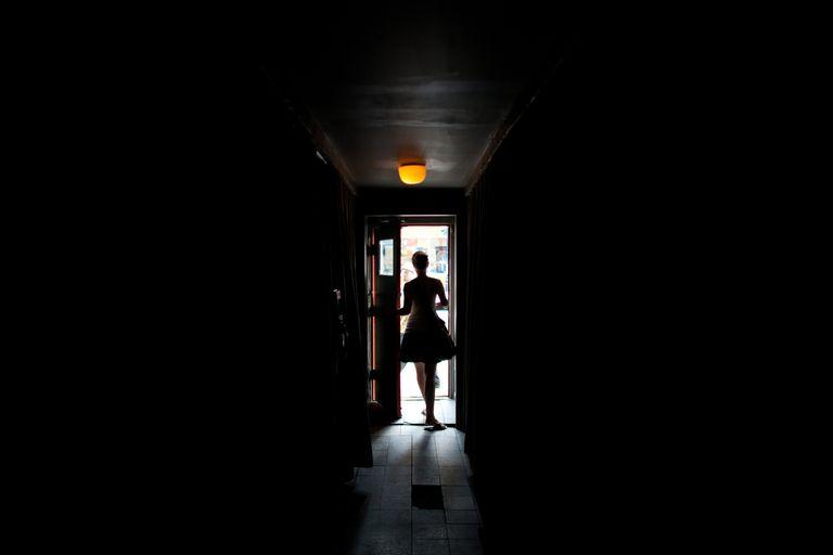 Woman leaving building