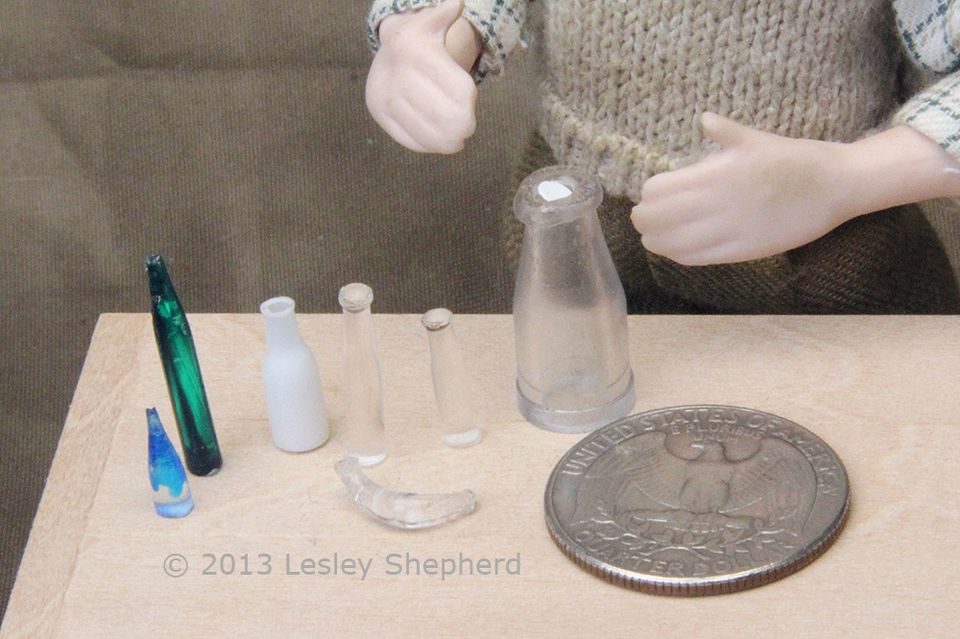 Plastic bottles in miniature scale made from recycled plastic rods, and straws.