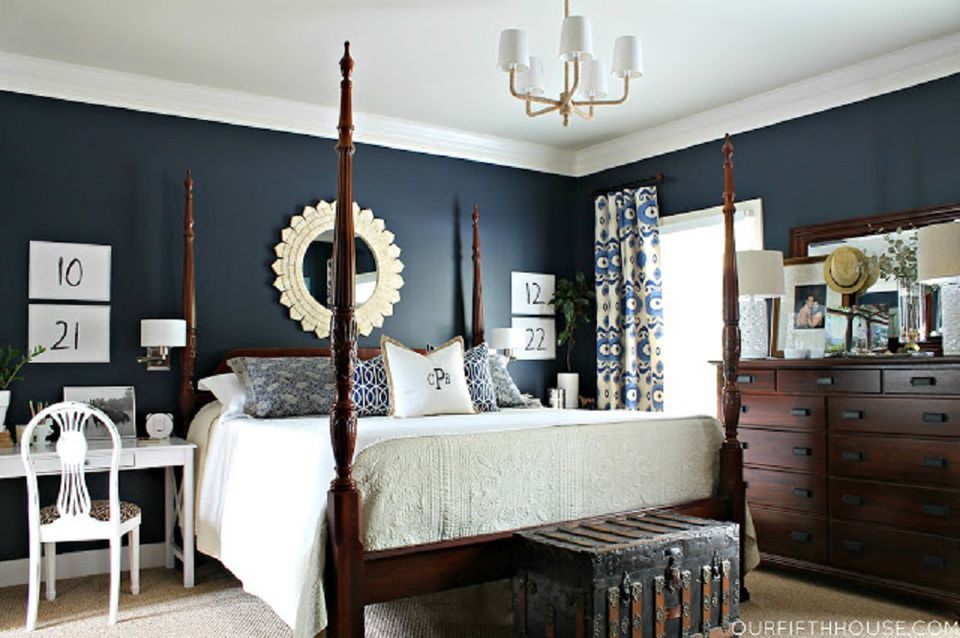 Bedroom with dark blue walls.