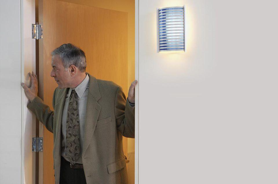 Standing in doorway