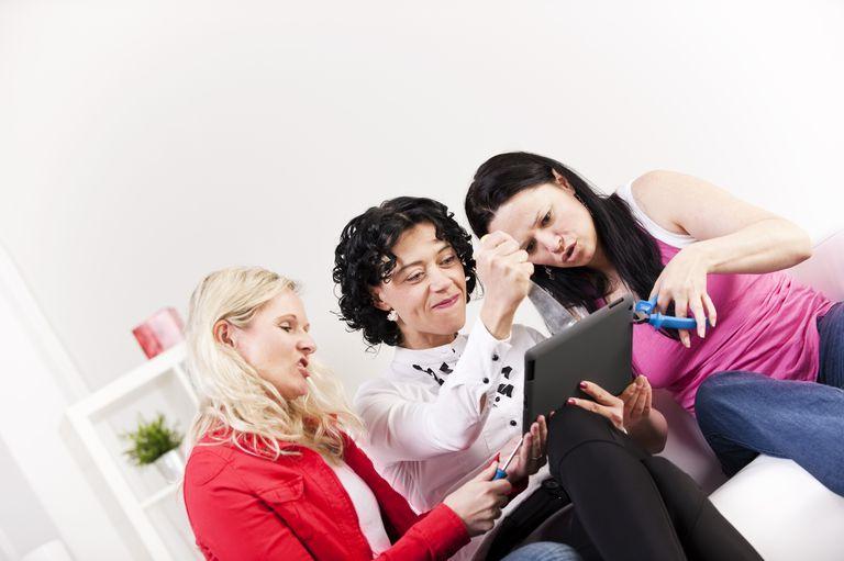 Three women angry at iPad