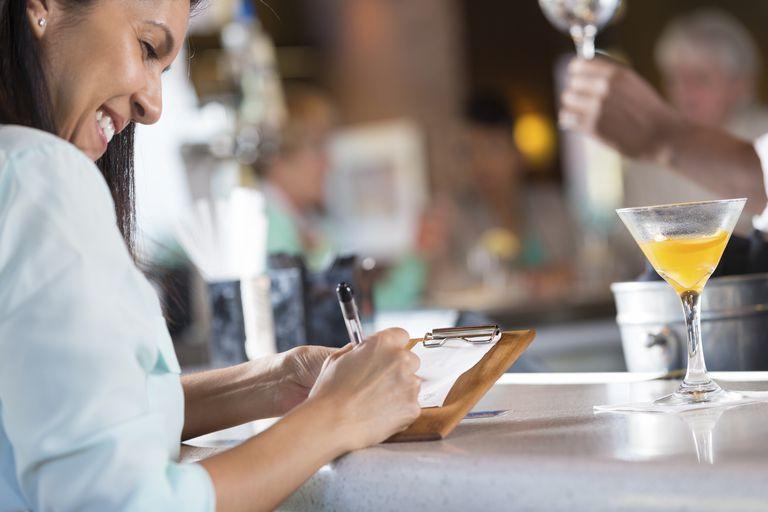Woman paying bill at restaurant