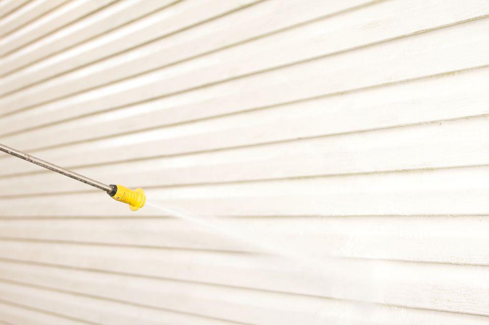 Pressure washing exterior wall
