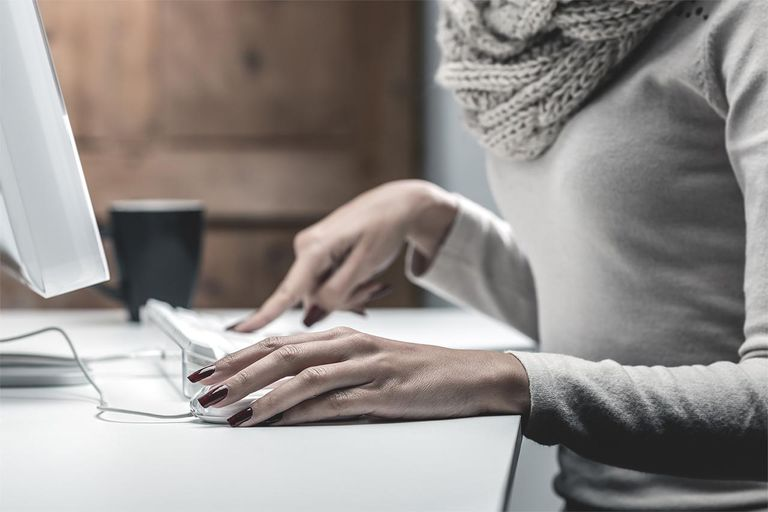 Elegant female's hands typing computer keyboard