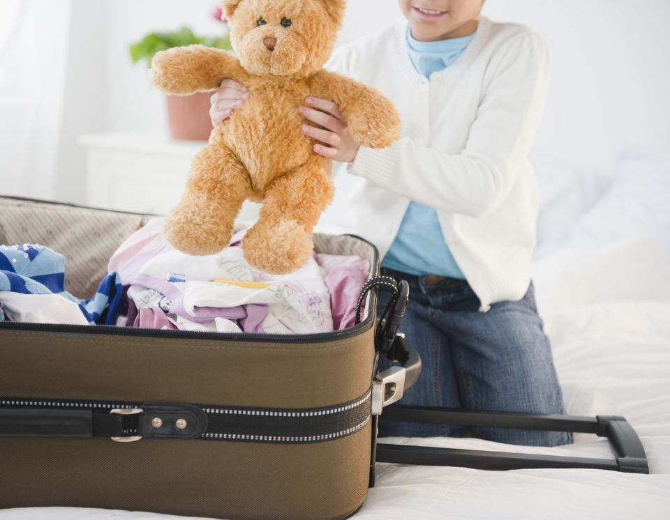 Child packing suitcase