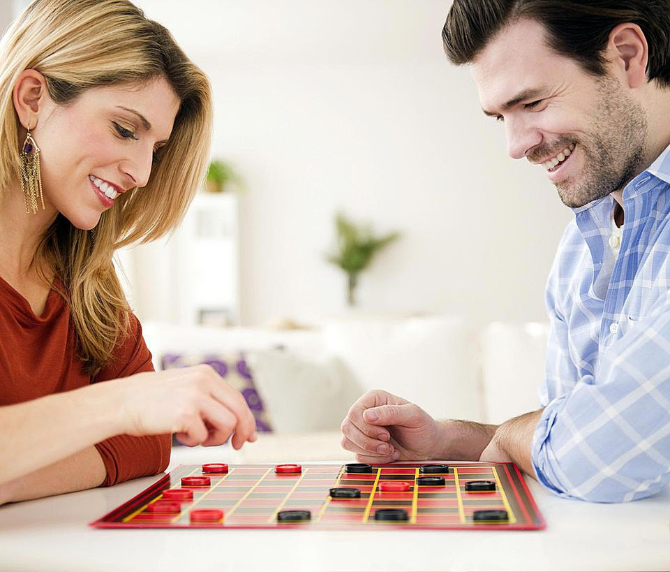 Couple playing checkers together