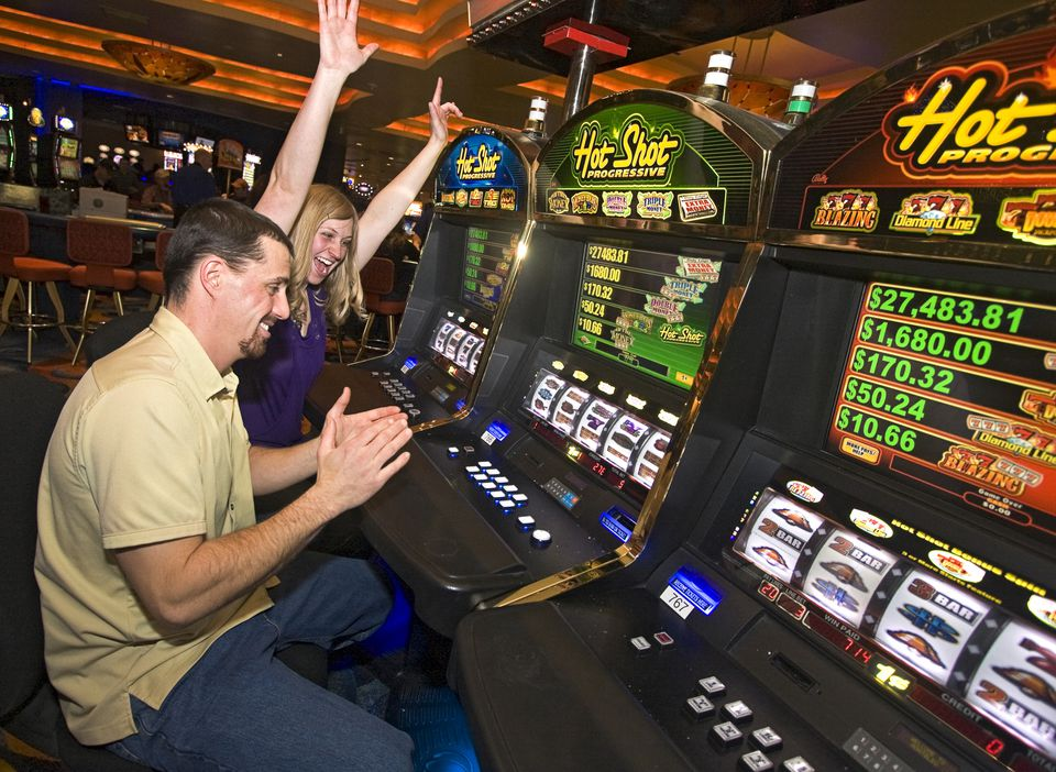Excited players at slot machines in gambling resort, South Lake Tahoe, Nevada